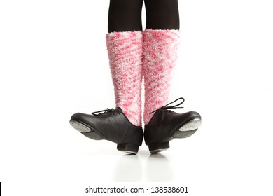 Girl's Dancing feet in tap shoes and pink socks