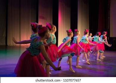 Girls are dancing on stage.
