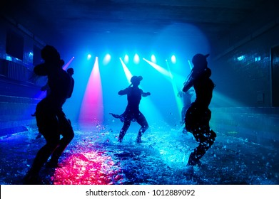 Girls dancing on the water with beautiful light.