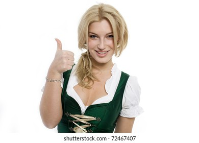 Girls in dirndl holding thumbs up