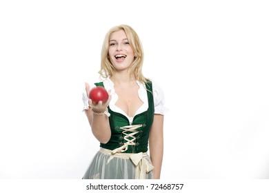Girls Dirndl throws an apple in the air