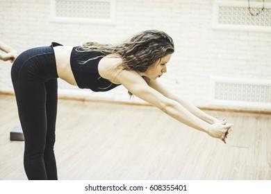Girls do exercises on morning training