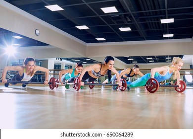 Girls do push ups from floor in the gym. Group training