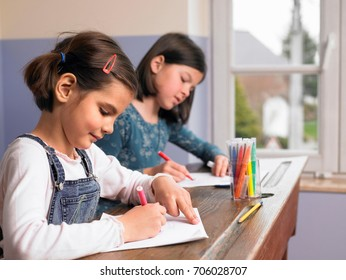Girls drawing a picture