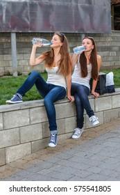 Girls drinking water a summer day