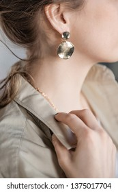 Girl's ear and gold earring