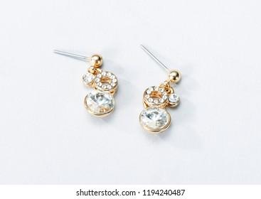 Girl's earrings on white