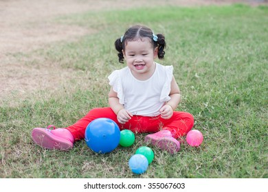 Girls enjoy playing ball lawn.