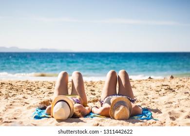 Girls enjoying the beach. Sunny day in the beach