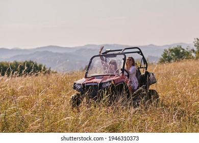 girls enjoying a beautiful sunny day while driving an off-road car