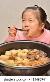 Girls enjoying the Sukiyaki