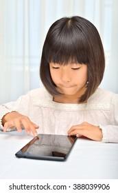 Girls enjoying with Tablet PCs