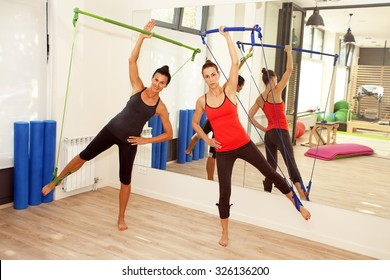 Girls are exercising pilates with gym sticks
