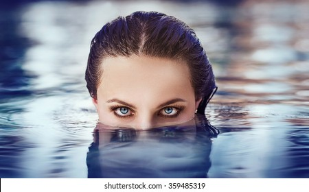 the girl's eyes above the water