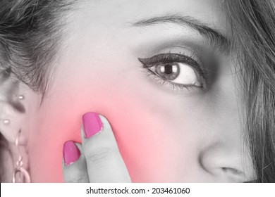 girl's face with pain in cheek color toned pink closeup
