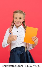 Girls famous for obsession with stationery. Kid school uniform hold book. Stationery admirer. Schoolgirl show notepad. School supplies concept. School stationery. Buy cute stationery for fun studying.