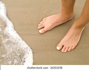 girl's feet on the beach