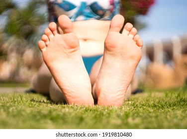 girl's feet on the grass. yoga classes. close-up.