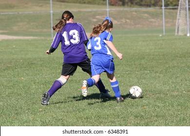 Girls Fighting for Soccer Ball