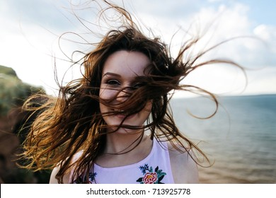 the girl's flying hair from wind