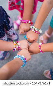 Girls friends with colorful bead bracelets