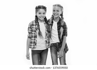 Girls friends wear similar outfits have same hairstyle kanekalon braids white background. Sisters family look outfit. Dress similar with best friend. Dress to match your friend. Best friend dressing.
