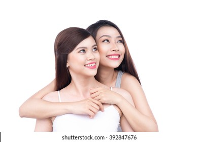 Girls friends. young beautiful asian girls hugs in front of white background