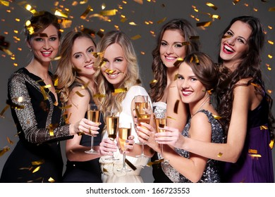 Girls with a glass of champagne meet new year