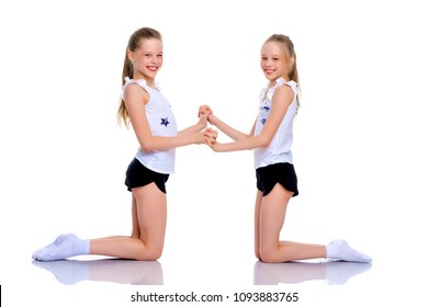 Girls gymnasts perform exercises. The concept of strength, health and sport. Isolated on white background.