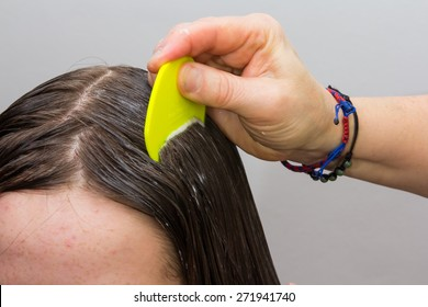 Girls hair being examined and cleaned for lice