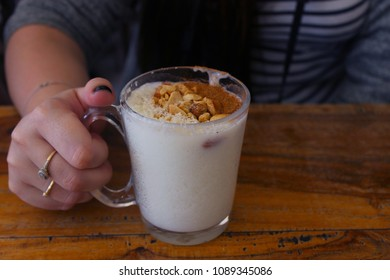 Girl's hand hold Traditional Turkish Drink Salep