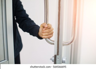 Girl's hand open the door with glass reflection background