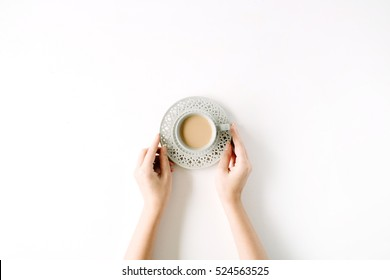 girl's hands holding coffee cup. flat lay, top view