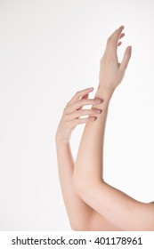 girl's hands with a natural nail polish on a white background massaged and stroked