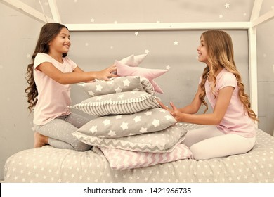 Girls happy best friends in pajamas with pillows sleepover party. Soulmates girls having fun sleepover party. Pillow fight pajama party. Sleepover time for fun. Best girls sleepover party ideas.