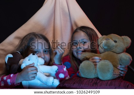 Girls with happy faces playing with teddies. PJs party for children.  Children and fun 1715a5aed