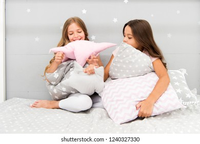 Girls happy friends with cute pillows. Pillow fight pajama party. Sleepover time for pillow fight. Doing whatever they want. Girls sleepover party ideas. Soulmates girls having fun sleepover party.