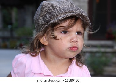 girls in a hat with a pouty face