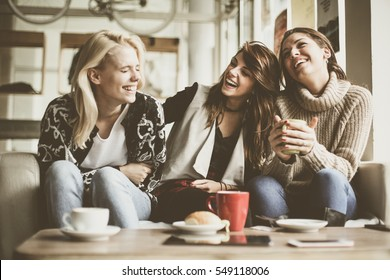 Girls having fun at home, laughing.