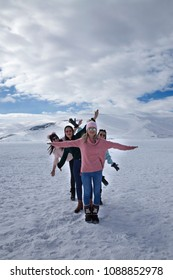 Girls having fun on the frozen Cildir Lake (Cildir Golu), Ardahan nearby Kars in Turkey