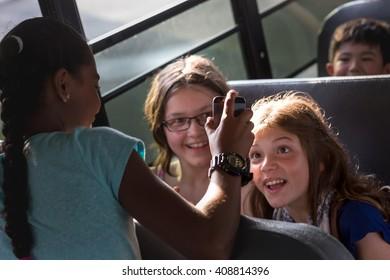 girls having fun on the School bus