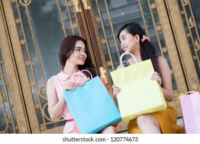 Girls having rest after shopping