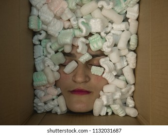 Girls head in a box.