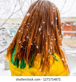 The girl's head in snowflakes. Snowflakes on girl's hair.