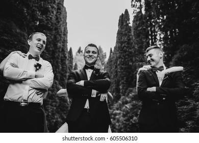 Girls hide behind groom and groomsmen