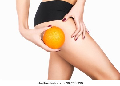 Girl's hip and an orange. Anti-cellulite program