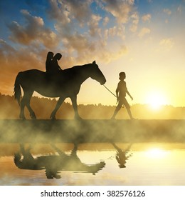 Girls with a horse at sunset