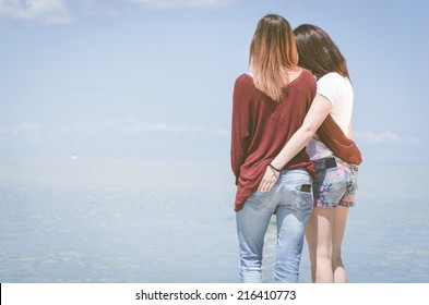 girls hugging on the pier