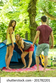 girls inviting a boy in their tent