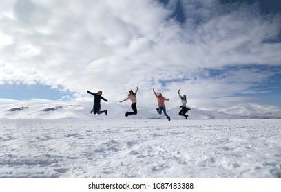 Girls jumping on the frozen Cildir Lake (Cildir Golu), Ardahan near Kars.